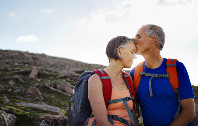 A Couple Kissing On A Mountain